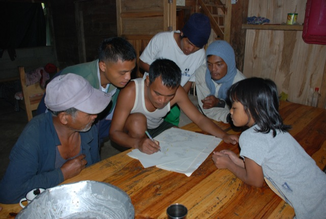 my host family checked my sheet of rice terrace ownership. Kalinga/Philippines,2007